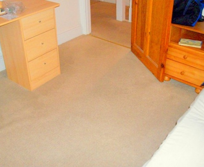 A freshly cleaned bedroom carpet